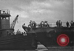Image of USS California (BB-44) being moved to drydock Pearl Harbor Hawaii USA, 1942, second 29 stock footage video 65675061839