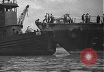 Image of USS California (BB-44) being moved to drydock Pearl Harbor Hawaii USA, 1942, second 30 stock footage video 65675061839