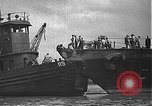 Image of USS California (BB-44) being moved to drydock Pearl Harbor Hawaii USA, 1942, second 31 stock footage video 65675061839