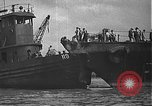Image of USS California (BB-44) being moved to drydock Pearl Harbor Hawaii USA, 1942, second 32 stock footage video 65675061839