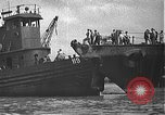 Image of USS California (BB-44) being moved to drydock Pearl Harbor Hawaii USA, 1942, second 33 stock footage video 65675061839