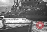 Image of USS California (BB-44) being moved to drydock Pearl Harbor Hawaii USA, 1942, second 34 stock footage video 65675061839