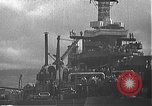 Image of USS California (BB-44) being moved to drydock Pearl Harbor Hawaii USA, 1942, second 35 stock footage video 65675061839