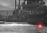 Image of USS California (BB-44) being moved to drydock Pearl Harbor Hawaii USA, 1942, second 36 stock footage video 65675061839