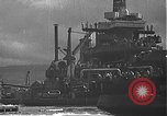 Image of USS California (BB-44) being moved to drydock Pearl Harbor Hawaii USA, 1942, second 37 stock footage video 65675061839