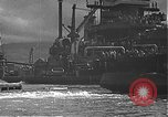 Image of USS California (BB-44) being moved to drydock Pearl Harbor Hawaii USA, 1942, second 38 stock footage video 65675061839