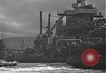 Image of USS California (BB-44) being moved to drydock Pearl Harbor Hawaii USA, 1942, second 39 stock footage video 65675061839