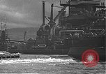 Image of USS California (BB-44) being moved to drydock Pearl Harbor Hawaii USA, 1942, second 40 stock footage video 65675061839