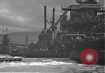 Image of USS California (BB-44) being moved to drydock Pearl Harbor Hawaii USA, 1942, second 41 stock footage video 65675061839