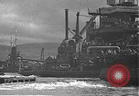 Image of USS California (BB-44) being moved to drydock Pearl Harbor Hawaii USA, 1942, second 42 stock footage video 65675061839