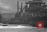 Image of USS California (BB-44) being moved to drydock Pearl Harbor Hawaii USA, 1942, second 43 stock footage video 65675061839