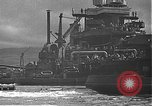 Image of USS California (BB-44) being moved to drydock Pearl Harbor Hawaii USA, 1942, second 44 stock footage video 65675061839