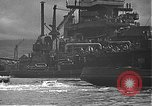 Image of USS California (BB-44) being moved to drydock Pearl Harbor Hawaii USA, 1942, second 45 stock footage video 65675061839