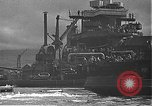 Image of USS California (BB-44) being moved to drydock Pearl Harbor Hawaii USA, 1942, second 46 stock footage video 65675061839