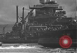 Image of USS California (BB-44) being moved to drydock Pearl Harbor Hawaii USA, 1942, second 48 stock footage video 65675061839