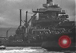 Image of USS California (BB-44) being moved to drydock Pearl Harbor Hawaii USA, 1942, second 49 stock footage video 65675061839