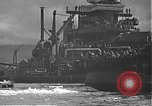 Image of USS California (BB-44) being moved to drydock Pearl Harbor Hawaii USA, 1942, second 50 stock footage video 65675061839