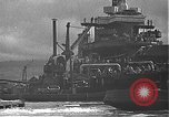 Image of USS California (BB-44) being moved to drydock Pearl Harbor Hawaii USA, 1942, second 51 stock footage video 65675061839