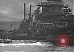 Image of USS California (BB-44) being moved to drydock Pearl Harbor Hawaii USA, 1942, second 52 stock footage video 65675061839