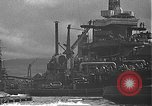 Image of USS California (BB-44) being moved to drydock Pearl Harbor Hawaii USA, 1942, second 53 stock footage video 65675061839