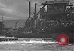 Image of USS California (BB-44) being moved to drydock Pearl Harbor Hawaii USA, 1942, second 54 stock footage video 65675061839