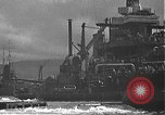 Image of USS California (BB-44) being moved to drydock Pearl Harbor Hawaii USA, 1942, second 55 stock footage video 65675061839