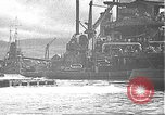 Image of USS California (BB-44) being moved to drydock Pearl Harbor Hawaii USA, 1942, second 56 stock footage video 65675061839