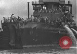 Image of USS California (BB-44) being moved to drydock Pearl Harbor Hawaii USA, 1942, second 57 stock footage video 65675061839