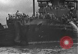 Image of USS California (BB-44) being moved to drydock Pearl Harbor Hawaii USA, 1942, second 58 stock footage video 65675061839