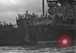 Image of USS California (BB-44) being moved to drydock Pearl Harbor Hawaii USA, 1942, second 60 stock footage video 65675061839