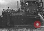 Image of USS California (BB-44) being moved to drydock Pearl Harbor Hawaii USA, 1942, second 61 stock footage video 65675061839