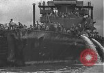 Image of USS California (BB-44) being moved to drydock Pearl Harbor Hawaii USA, 1942, second 62 stock footage video 65675061839