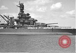 Image of USS Colorado (BB-45) maneuvering to Berth F-12A Pearl Harbor Hawaii USA, 1942, second 18 stock footage video 65675061843