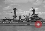 Image of USS Colorado (BB-45) maneuvering to Berth F-12A Pearl Harbor Hawaii USA, 1942, second 28 stock footage video 65675061843