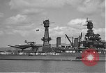 Image of USS Colorado (BB-45) maneuvering to Berth F-12A Pearl Harbor Hawaii USA, 1942, second 32 stock footage video 65675061843
