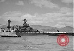 Image of USS Colorado (BB-45) maneuvering to Berth F-12A Pearl Harbor Hawaii USA, 1942, second 58 stock footage video 65675061843