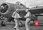 Image of LCDR John Thach and Lt. Edward O'Hare preparing for a flight Kaneohe Hawaii USA, 1942, second 7 stock footage video 65675061850