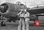 Image of LCDR John Thach and Lt. Edward O'Hare preparing for a flight Kaneohe Hawaii USA, 1942, second 16 stock footage video 65675061850