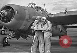 Image of LCDR John Thach and Lt. Edward O'Hare preparing for a flight Kaneohe Hawaii USA, 1942, second 18 stock footage video 65675061850