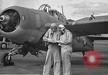Image of LCDR John Thach and Lt. Edward O'Hare preparing for a flight Kaneohe Hawaii USA, 1942, second 26 stock footage video 65675061850