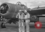 Image of LCDR John Thach and Lt. Edward O'Hare preparing for a flight Kaneohe Hawaii USA, 1942, second 28 stock footage video 65675061850