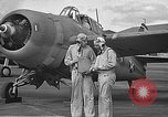 Image of LCDR John Thach and Lt. Edward O'Hare preparing for a flight Kaneohe Hawaii USA, 1942, second 32 stock footage video 65675061850