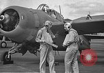Image of LCDR John Thach and Lt. Edward O'Hare preparing for a flight Kaneohe Hawaii USA, 1942, second 34 stock footage video 65675061850