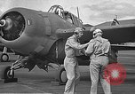 Image of LCDR John Thach and Lt. Edward O'Hare preparing for a flight Kaneohe Hawaii USA, 1942, second 35 stock footage video 65675061850
