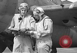 Image of LCDR John Thach and Lt. Edward O'Hare preparing for a flight Kaneohe Hawaii USA, 1942, second 44 stock footage video 65675061850
