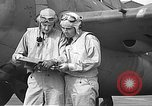 Image of LCDR John Thach and Lt. Edward O'Hare preparing for a flight Kaneohe Hawaii USA, 1942, second 45 stock footage video 65675061850