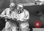 Image of LCDR John Thach and Lt. Edward O'Hare preparing for a flight Kaneohe Hawaii USA, 1942, second 46 stock footage video 65675061850