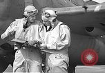 Image of LCDR John Thach and Lt. Edward O'Hare preparing for a flight Kaneohe Hawaii USA, 1942, second 48 stock footage video 65675061850
