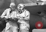 Image of LCDR John Thach and Lt. Edward O'Hare preparing for a flight Kaneohe Hawaii USA, 1942, second 49 stock footage video 65675061850