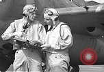 Image of LCDR John Thach and Lt. Edward O'Hare preparing for a flight Kaneohe Hawaii USA, 1942, second 52 stock footage video 65675061850